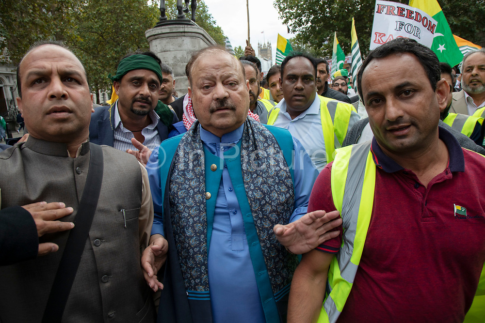Ex-Prime Minister of Azad Kashmir Sultan Mehmood Chaudhry joins the Demonstration to free Kashmir in Westminster on 3rd September 2019 in London, United Kingdom. Kashmiris waving flags gathered in Westminster and marched along Whitehall in protest at Indian Prime Minister Narendra Modi's removal of the special autonomous region rights of Kashmir. Sultan Mehmood Chaudhry is a Pakistani politician who hails from Azad Kashmir, Pakistan. He served as Prime Minister of Azad Kashmir between July 1996 - July 2001.