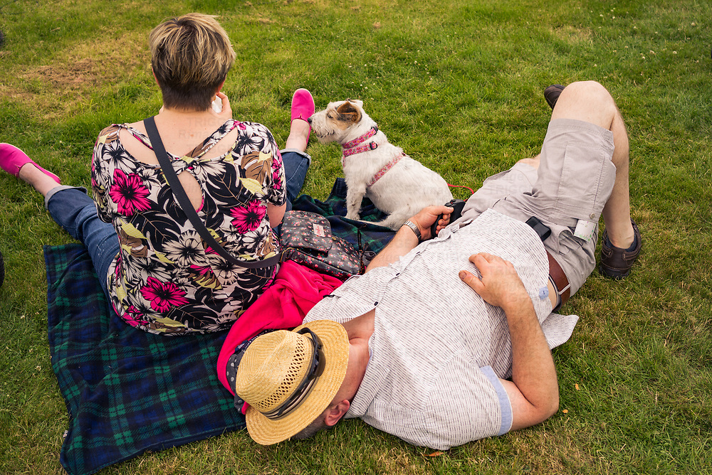 A middle aged couple with a small Jack Russell dog.
