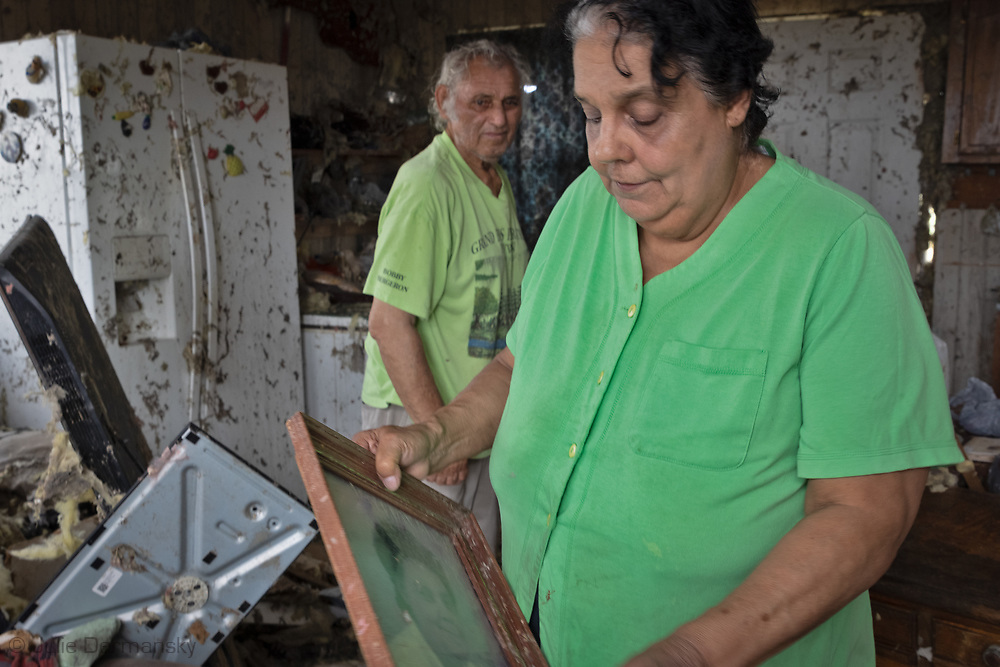 Edison Dardar and Elizabeth Dardar in what remains of her  n what his home that no longer has a roof on the Isle de Jean Charle