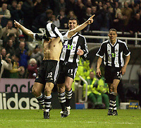 Photo. Jed Wee<br />Newcastle United v Arsenal, FA Barclaycard Premiership, St. James' Park, Newcastle. 09/02/2003.<br />Newcastle's Laurent Robert (L) celebrates with team mates Gary Speed (C) and Jermaine Jenas after scoring.