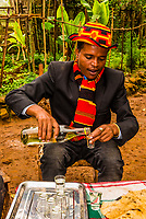 A Dorze man pours Araqe during the Meskel celebration, Southern Nations Nationalities and People's Region, Ethiopia.