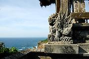 Stone carving overlooking ocean. Uluwatu Temple, Bali, Indonesia.