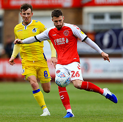 James Husband of Fleetwood Town clears the ball under pressure from Ollie Clarke of Bristol Rovers - Mandatory by-line: Matt McNulty/JMP - 27/04/2019 - FOOTBALL - Highbury Stadium - Fleetwood, England - Fleetwood Town v Bristol Rovers - Sky Bet League One