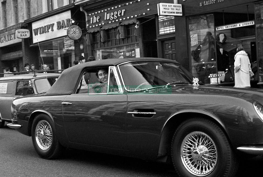 File photo dated 04/02/71 of the Prince of Wales at the wheel of his 5500 Aston Martin DB6 convertible sports car, driving along London's Strand after visiting the Press Association in Fleet Street.