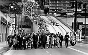 A march estimated at 10,000 people makes its way to Memorial Stadium at Seattle Center on April 7, 1968, for a tribute to Martin Luther King Jr., three days after the civil-rights leader was killed. (Bruce McKim/The Seattle Times, 1968)