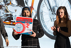 """Francesco """"Frankino"""" Torreslimare of Chop Works gets an award for his new custom Triumph in the LowRide Magazine Italy's bike show award ceremony at Motor Bike Expo. Verona, Italy. Sunday January 21, 2018. Photography ©2018 Michael Lichter."""