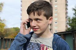 Teenage boy talking on mobile phone
