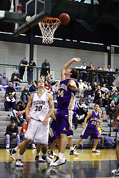 30 December 2006: Zach Freeman and Tom Jurasek watch the ball fall off the rim in hopes of a rebound. The Titans outscored the Britons by a score of 94-80. The Britons of Albion College visited the Illinois Wesleyan Titans at the Shirk Center in Bloomington Illinois.<br />