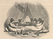 'The McClure Arctic Expedition of 1850, one of the  numerous search efforts to determine the fate of Sir John Franklin's lost expedition. Memebrs of the crew of HMS'' Resolute'' in camp in their Arctic clothing and sleeing bags. Engraving.'