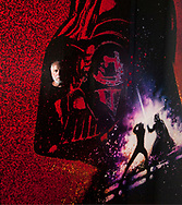 """Drew Struzan, reflected in the original art for the famous """"Revenge of the Jedi"""" poster.  The work was created as a teaser for the third """"Star Wars"""" movie, but the posters printed from the work were ordered destroyed at the last minute because George Lucas decided Jedis didn't believe in """"Revenge"""" and changed the title to """"Return of the Jedi.""""  The piece is on a rare public display from George Lucas' collection in the """"Drew & Bob – The Masters of Movie Art"""" exhibit at the Forest Lawn Museum in Glendale."""