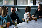 """Guests enjoy a social hour before the """"Corner Table Podcast"""" recording at Old Sugar Distillery in Madison, Wisconsin, Tuesday, June 18, 2019."""