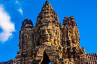 Stone faces adorn the South Gate, Angkor Thom (Angkor Wat Complex), Cambodia.
