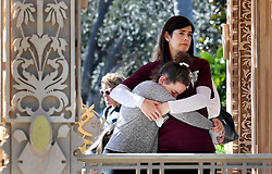 "Cami Merkur, 11, hugs her mother, Kelly, as they visit The Temple of Time, the first of five public art installations in Coral Springs and Parkland as part of a winning series, ""Inspiring Community Healing After Gun Violence: The Power of Art,"" officially opened for reflection Thursday, February 14, 2019, on the one-year-anniversary of the Parkland school shooting. Photo by Taimy Alvarez/Sun Sentinel/TNS/ABACAPRESS.COM"
