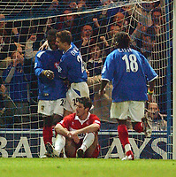 Fotball<br /> England 2004/2005<br /> Foto: SBI/Digitalsport<br /> NORWAY ONLY<br /> <br /> Portsmouth v Middlesborough<br /> 1/2/2005.<br /> Barclays Premiership.<br /> Portsmouth's Yakubu celebrates his goal with Gary O'Neil while Boro's Frank Queudrue can only sit and watch.