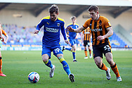 AFC Wimbledon attacker Shane McLoughlin (19) battles for possession with Hull City midfielder Greg Docherty (33) during the EFL Sky Bet League 1 match between AFC Wimbledon and Hull City at Plough Lane, London, United Kingdom on 27 February 2021.