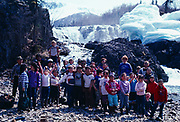 Park Ranger Andy Balluta with school children from the Native village of Newhalen on field trip to Tanalian Falls, Lake Clark National Park, Alaska