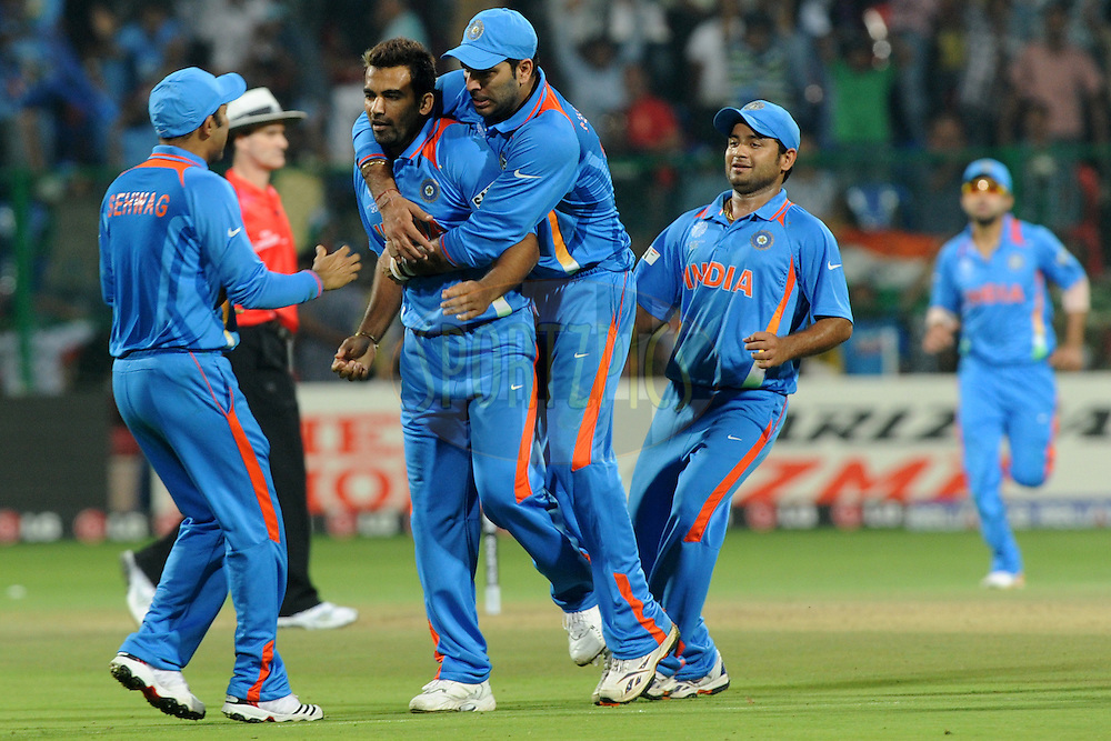 Zaheer Khan of India celebrate the wicket of Paul Collingwood of England during the ICC Cricket World Cup match between India and England held at the M Chinnaswamy Stadium in Bengaluru, Bangalore, Karnataka, India on the 27th February 2011..Photo by Pal Pillai/BCCI/SPORTZPICS