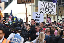 © Licensed to London News Pictures. 11/07/2019. London, UK. Supporters of Tommy Robison react after the sentence. Supporters of activist Stephen Yaxley-Lennon Known as Tommy Robinson, gather outside The Old Bailey in London ahead of his sentence. The former leader of the English Defence League (EDL) is being sentenced for contempt of court for filming defendants at a trial at Leeds Crown Court and broadcast the video on social media. Photo credit: Ben Cawthra/LNP