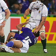 Heinrich Briussow, South Africa, tries to get released from the grip of Paul WIlliams, Samoa during the South Africa V Samoa, Pool D match during the IRB Rugby World Cup tournament. North Harbour Stadium, Auckland, New Zealand, 30th September 2011. Photo Tim Clayton...