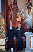 Moscow, Russia, 06/01/2001..German Chancellor Gerhard Schroeder and his wife Doris visit Moscow. President Putin and wife Ludmilla cross themselves during Orthodox Christmas service in the Cathedral of Christ the Saviour accompanied by the Schroeders....
