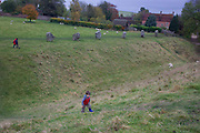 A small boy climbs up the gradient of the outer ditch that surrounds Avebury, the ancient site in southern England. The Avebury complex is one of the principal ceremonial sites of Neolithic Britain that we can visit today. It was built and altered over many centuries from about 2850 BC until about 2200 BC and is one of the largest, and undoubtedly the most complex, of Britain's surviving Neolithic henge monuments. There were originally 98 sarsen standing stones, some weighing in excess of 40 tons and varied in height from 3.6 to 4.2. Avebury is designated a World Heritage Site. Entrance is free.