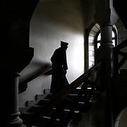 A monk in the granite staircase called de Juigne serving the cells and the infirmary. Solesmes on 17-10-2019<br /> Un moine dans l'escalier de granit dit de Juigne desservant les cellules et l'infirmerie. Solesmes le 17-10-2019