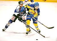 Ishockey , Get-Ligaen,<br /> 30.01.14<br /> Hamar OL-Amfi<br /> Storhamar v Sparta  2-1 (e.f)<br /> Foto : Dagfinn Limoseth , Digitalsport<br /> Logan Stephanson , Sparta og Christian Larriveé , Storhamar