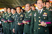 29 SEPTEMBER 2014 - NAKHON NAYOK, NAKHON NAYOK, THAILAND: Senior Thai army officers stand at attention during the Thai national anthem at the retirement ceremony for more than 200 Thai generals including Gen. Prayuth Chan-ocha, who led the 22 May coup against the civilian government earlier this year. Prayuth has been chief of the Thai army since 2010. After his retirement, Gen. Prayuth will retain his posts as head of the junta's National Council for Peace and Order (NCPO) and Prime Minister of Thailand. Under Thai law, military officers must retire at 60 years of age. The 200 generals who retired with Prayuth were also his classmates at the Chulalomklao Royal Military Academy in Nakhon Nayok.    PHOTO BY JACK KURTZ
