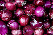 a stack of red Onions