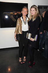 Left to right, MARTHA WARD and PHILIPPA HOLLAND at a private view of photographs by Guido Mocafico entitled 'Guns and Roses' held at Hamiltons Gallery, 13 Carlos Place, London W1 on 21st January 2010.