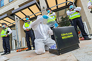 As a way to step up pressure on Shell and demand an end on fossil fuel extraction as well as ecocide, Extinction Rebellion protestors 'crime scene investigation - forensic unit' performed a crime scene investigation protest outside Shell Headquarters in Jubilee Gardens, central London on Tuesday, Sept 8, 2020. Environmental nonviolent activists group Extinction Rebellion enters its 8th day of continuous ten days protests to disrupt political institutions throughout peaceful actions swarming central London into a standoff, demanding that central government obeys and delivers Climate Emergency bill. (VXP Photo/ Vudi Xhymshiti)
