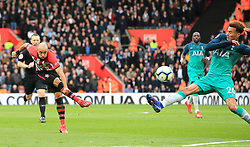 Southampton's Nathan Redmond (left) shoots towards goal
