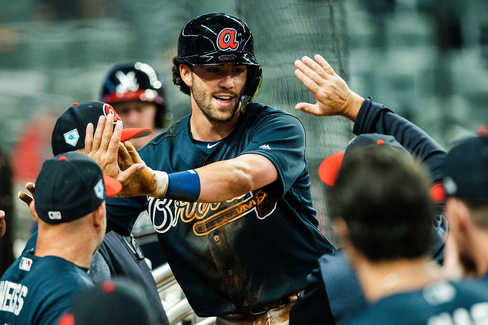 Dansby Swanson celebrates scoring a home run during Braves v. Reds exhibition game on Monday, March 25, 2018 at SunTrust Park. The Braves won 8-5. Photo by Kevin D. Liles/Atlanta Braves
