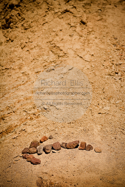 Stones arrange in an arrow shape at the badlands at Golden Canyon in Death Valley National Park, Nevada, USA.
