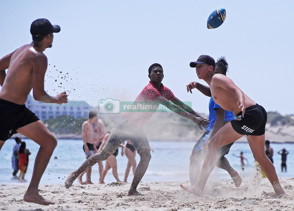 """South Africa Cape Town 06 December 2019 - Weather pic - The Western Cape has seen fine weather conditions this week with temperature souring to above 30 degrees Celsius. On Gordon's Bay Beach, A group of friends played """"Beach Touch Rugby"""" on the beach. Phographer: Tracey Adams/African News Agency"""