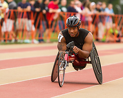 Mens' Wheelchair Mile, James Senbeta wins