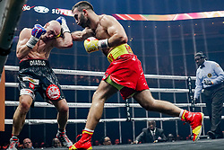 October 21, 2017 - Newark, New Jersey, USA - MURAT GASSIEV (red and yellow trunks) and KRZYSZTOF WLODARCZYK battle in a cruiserweight bout at the Prudential Center in Newark, New Jersey. (Credit Image: © Joel Plummer via ZUMA Wire)