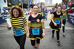 © Licensed to London News Pictures . 19/05/2019. Manchester, UK. Participants at the finish line of the 10k run in the Great Manchester Run in Manchester City Centre . Photo credit : Joel Goodman/LNP