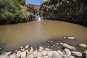 Israel, Golan Heights, Yehudiya Forest Nature Reserve Meshushim Pool - hexagon pool so called because of the shape of the basalt rocks in the cliff in Nahal Zavitan [Zavitan Stream]