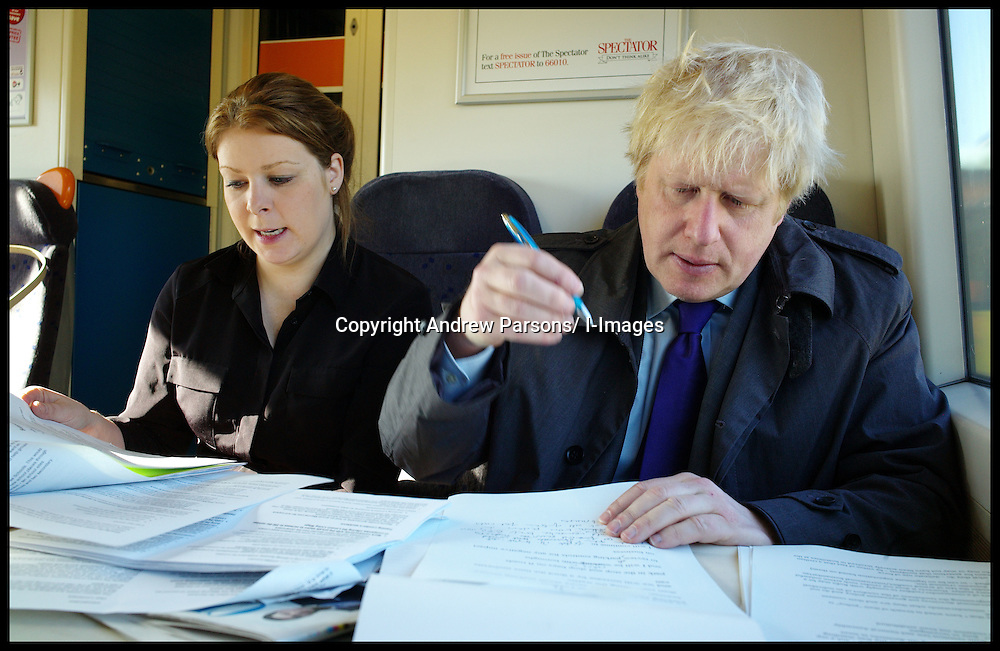 The London Mayor Boris Johnson working on the train to Croydon with Amy Selman, where he will launch his economy manifesto, April 4, 2012. Photo By Andrew Parsons/ i-Images...