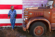Image of a guy next to a truck along Route 66 in Seligman, Arizona, America Southwest by Randy Wells
