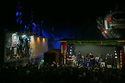 Sleaford Mods plays live at Banksy's Dismaland. The image of PM Cameron is part of an artwork by kennardphillipps called 'Shove'. Singer Jason Williamsen often refered to the iamge of Cameron, at one point as the 'cunt in the corner'.