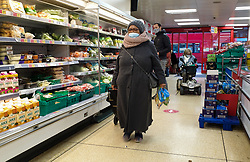 © Licensed to London News Pictures. 12/01/2021. London, UK. A shopper wearing a protective face covering in Iceland supermarket in north London, as the government is likely to enforce that shoppers must wear a face covering whilst shopping, unless they are medically exempt and should socially distance from other people. Photo credit: Dinendra Haria/LNP