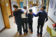 T. T. Minor boys support a classmate with a minor playground injury as they head for the school nurse.  From left:  Jacob Baker (CQ), Terry Lewis II (CQ), Treyshaun Sinclair (CQ), Trayve'on Scott (CQ).<br /> <br /> <br /> T.T. Minor Elementary School, for Pacific Northwest Magazine