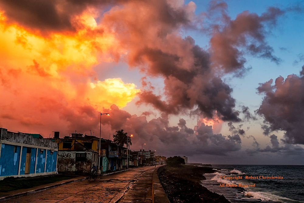 Dramatic Morning - Baracoa: Early morning clouds form a dramatic display of colour over the ocean and the awakening town of Baracoa Cuba.