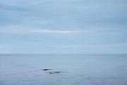 Waves in calm sea at Aberaeron in Cardigan Bay, Pembrokeshire coastline, Wales, UK