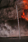 he devastated desert landscape in the burning greater Al Burgan oil fields in Kuwait after the end of the Gulf War. More than 700 wells were set ablaze by retreating Iraqi troops creating the largest man-made environmental disaster in history.