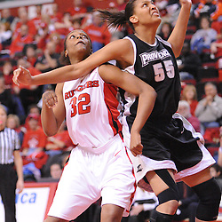 Feb 21, 2009; Piscataway, NJ, USA; Rutgers forward Brooklyn Pope (32) battles against Providence center Jessica Clark (55) for a free throw rebound during the first half of Rutgers' 55-42 victory over Providence at the Louis Brown Athletic Center.