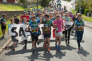 """People run on the 20th Korrika.  Hendaia (Basque Country). April 4, 2017. The """"Korrika"""" is a relay course, with a wooden baton that passes from hand to hand without interruption, organised every two years in a bid to promote the basque language. The Korrika runs over 11 days and 10 nights, crossing many Basque villages and cities. This year was the 20th edition and run more than 2500 Kilometres. Some people consider it an honour to carry the baton with the symbol of the Basques, """"buying"""" kilometres to support Basque language teaching. (Gari Garaialde / Bostok Photo)"""