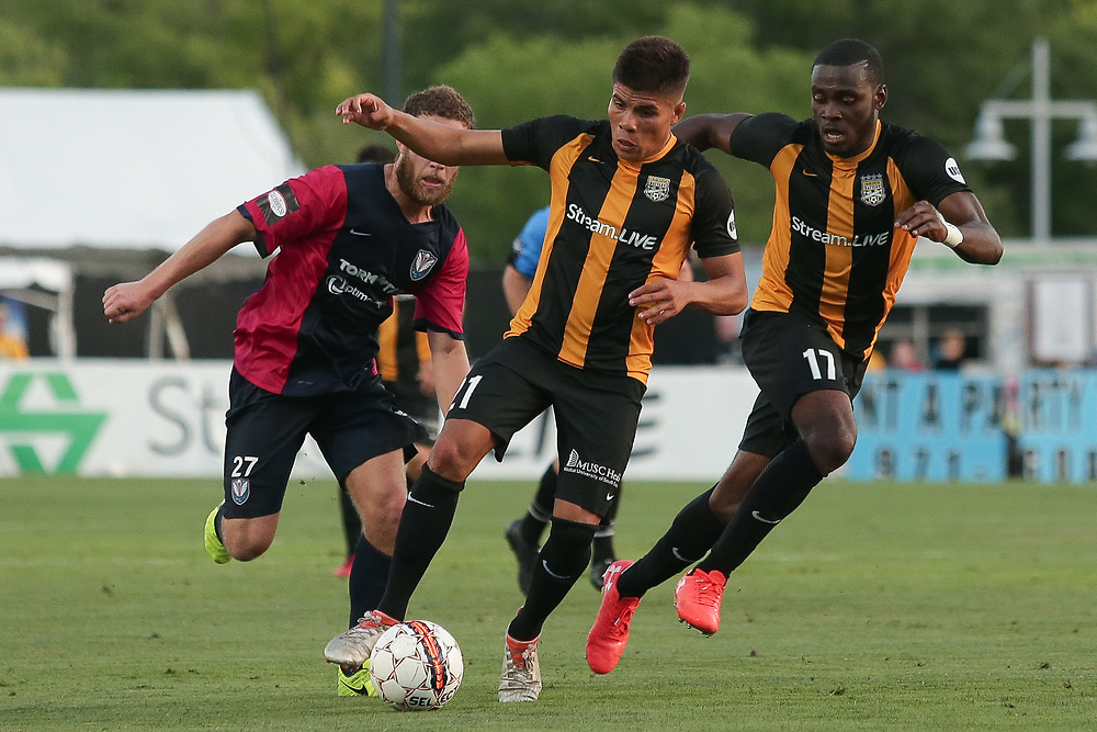 Angelo Kelly (21), Patrick Okonkwo (17). <br /> Lamar Hunt US Open Cup: Tormenta FC vs. Charleston Battery in the second round at MUSC Health Stadium in Charleston, S.C. on Wednesday, May 16, 2018.<br /> Zach Bland/Charleston Battery